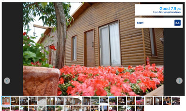 Screenshot of Ramot hotel listing shows cabin-style building